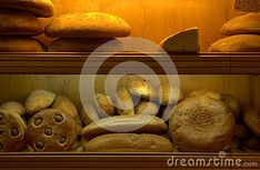 Photo about Bakery shop interior, bread on shop case, yellow artificial light. Image of food, shop, market - 133149488 Bakery Shop Interior, Recipe Images, Bread, Stock Photos, Yellow, Photography, Shopping, Food, Photograph