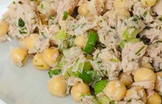 Spicy Chickpeas And Tuna 3 ounces olive-oil packed light tuna with ½ cup chickpeas and cayenne over 2 cups chopped romaine lettuce.