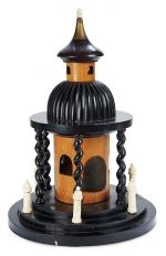 """ELABORATE AND WHIMSICAL WOODEN AND BONE GAZEBO AS SEWING CASE   16"""" (41 cm.) Designed to appear as a garden gazebo,of fine woods with natural and ebony finish,and having domed roof and cupola,the sewing case has bone pillars which are actually thread winders,attached pin-cushion to the tower wall,hollow tower which accesses by unscrewing the domed top,and a cupola which unscrews for access to another hidden compartment which holds a carved bone darning egg. English,mid-19th century."""
