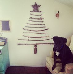 Love this version of a DIY Christmas tree. So rustic! Cute doggie, too.