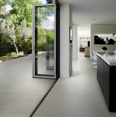 Create a free-flowing garden patio space that merges seamlessly into your kitchen / dining room! This indoor - outdoor look is a major interior design trend. Garden Tiles, Patio Tiles, Outdoor Tiles Patio, Outdoor Spaces, Indoor Outdoor Kitchen, Outdoor Stone, Outdoor Kitchens, Outside Flooring, Outdoor Flooring