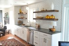 White subway tiles, white cabnets, cement counters, raw wood shelves; only exception black hardware, white farm sink -for kitchen