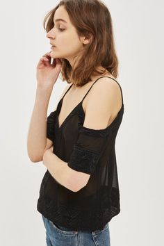 Embroidered cutout top in black.