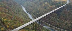 This is West Virginia's New River Gorge Bridge.  When you walk out onto the bridge during Bridge Day, you'll be standing over one of the oldest river gorges on Earth. By most accounts, it's the top contender for being the first river in North America.    The New River Gorge in West Virginia averages between 700 and 1300 feet deep. The gorge was formed solely due to erosion; there were no glaciers in the area like those that carved our similar gorges in other parts of the world.