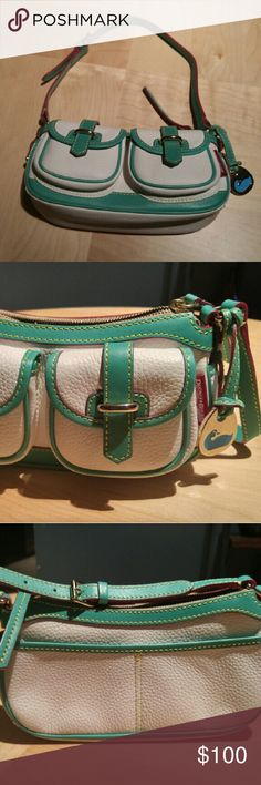 """LIKE NEW DOONEY& BOURKE MINI HANDBAG LIKE NEW CONDITION!!! White leather with green trim and red stitching. Red lining with blue duck charm. 9.5"""" wide 4.5"""" tall. No visible wear and tear. No stains or tears. Dooney & Bourke Bags Mini Bags"""