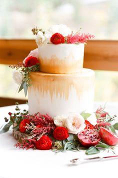 Modern gold floral topped wedding cake: http://www.stylemepretty.com/little-black-book-blog/2016/01/14/intimate-wild-basin-lodge-wedding/   Photography: Tamara Gruner - http://tamaragruner.com/