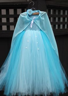 Custom Elsa from Frozen tutu dress. Knee length blue tulle, blue lined bodice, sparkly snowflake headband or hair clip, & adjustable straps