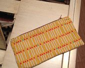 Check out this lovely zipper pouch from Caught Red Threaded!