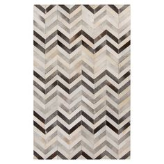 I get asked about my rug like this all the time: it's COWHIDE patchworked together and it's impossible to ruin--we've got 3 boys, a dog (and now 3 cats) and I'd buy this rug again and again.