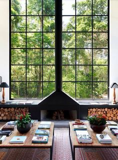 Fireplace in front of large window