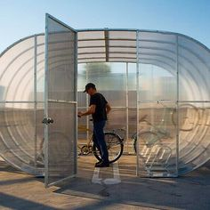 The Tube Arc is a modular, fully enclosed bike shed (these are customized according to the number of bicycle parking spots needed by the purchaser). Email sales@bikearc.com for additional info.