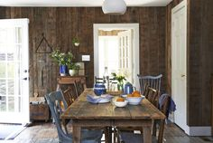 Reclaimed barnwood paneling serves pretty and practical purposes. It makes the space feel cozier and hides wear and tear better than painted walls.   - CountryLiving.com
