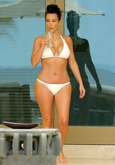 Kim Kardashian soaks up the sun in a sexy white bikini while honeymooning in Mexico with new husband Kanye West
