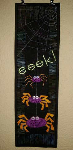 LOVE the idea of using large paper clips to hang changeable wall hangings.  And, of course, the hanging itself.