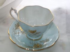 Vintage Queen Anne teacup   blue and gold teacup  by NewtoUVintage