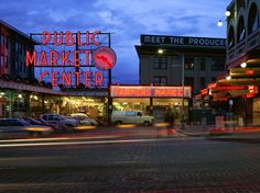 In operation for over a century, Seattle's iconic Pike Place Market showcases farmers and craftspeople, as well as businesses and restaurants. [Photo by Dean Fox, Photolibrary]