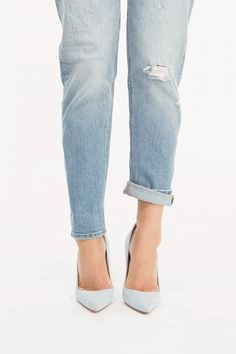 """The """"jean roll"""" to show off stilettos. See how to do it and 4 other fashion tricks editors swear by (this is #5 of 5).."""
