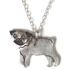Pug charm necklace  Give a pretty pug a home! This cheerful charm necklace is guaranteed to make you smile everytime you wear it. In solid silver with engraved detail.   Hand crafted in Cornwall by Justin Duance for Poppy Treffry.