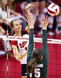 Nebraska outside hitter Morgan Broekhuis scores match point with a kill over a Michigan State blocker on Wednesday, Sept. 26, 2012, at the Coliseum.