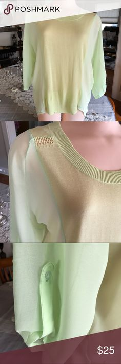"""Lime colored 3/4 tab sleeve blouse. B093 Lime colored 3/4 tab sleeve blouse. 2 different fabrics. 100% viscose. Sheer fabric. Small it's 20"""" across hips 26"""" across armpit to armpit and 29"""" long💕 Medium is 31"""" across hips 27"""" across armpit to armpit and 29"""" long💕💕 Large it's 22"""" across hips 28"""" across armpit to armpit 29"""" long. Ellison Tops Tunics"""