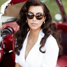 Vintage. Kim Kardashian. I am in love with her curls and cat eye sunglasses.
