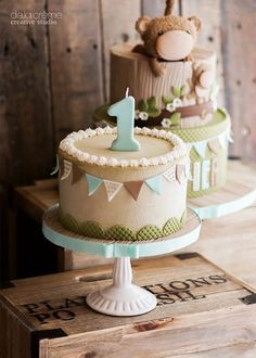 Adorable first birthday cake Brown green and blue