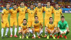 Australia line up for a team photo before the 2014 FIFA World Cup Brazil Group B match with Chile