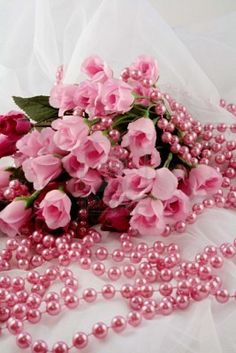 Pink Roses And Beads On White Lace (Royalty Free Stock Photo)