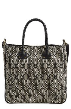 This bold black-and-white geo print tote will compliment almost any ensemble, making it a perfect go-to bag.
