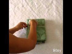 Como dobrar uma toalha com itens de higiene pessoal para hóspedes. - YouTube