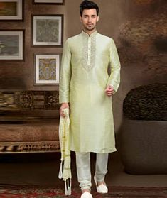 Wondrous off white ceremonial wear dupion kurta pyjama. Having fabric dupion and art silk. The embroidery work, stone work, resham embroidery work, zari work and thread work seems cool and great for any party. Comes with matching bottom. Yellow Fabric, White Fabrics, Krishna, Indian Fashion, Mens Fashion, Indian Kurta, Dupion Silk, How To Dye Fabric, Restaurant