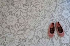 I want this flor in my craft room!! They have other floor designs on the website.  Super cool idea for concrete floors