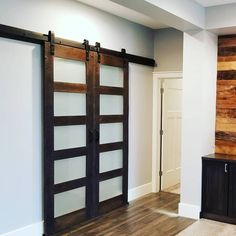 We can feature glass, tin and metal in our custom barn doors as well! This awesome duo would be great to help light still shine through areas in your home that you want private. Call us today to start your own project! Wood Doors, Barn Doors, Sliding Doors, Reclaimed Barn Wood, Tin, New Homes, Rustic, Metal, Awesome