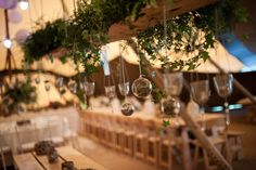 Wooden hanging swing with vintage votives