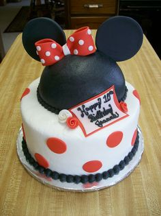 "Minnie Mouse birthday - Customer wanted a Disney themed cake but not princesses. We decided to go with Mickey and Minnie Mouse so I did the color scheme in the traditional red, black and white and added the bow for Minnie mouse as well as a few Duff roses around the banner. Hat is half dome cake and fondant ears on top of 8"" round cake. thank you cc decorators for inspiration."