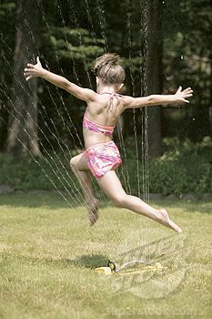As a kid, I spent MANY summers running through sprinklers or being sprayed with a garden hose. Yes, I wore bathing suits with attached skirts or bows on the hips.