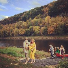 """""""Sisterhood of the Traveling Pants"""" star Amber Tamblyn's relaxed, festive wedding to """"Arrested Development"""" actor David Cross. The bride, wearing a canary yellow dress and flowers in her hair, arrived by canoe before walking barefoot down the aisle with her dad."""