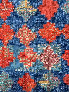Blue and orange log cabin, about 1930s-1940a. Blue Mountain Daisy: A finished quilt