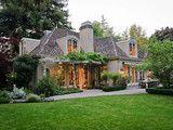 trailing vines, house looks nestled