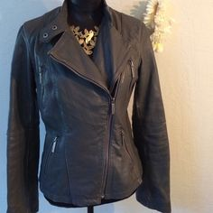 "Michael Kors leather jacket. Beautiful Michael Kors gray leather jacket.  Angled zipper with four zippered pockets. Gray interior.  20"" across underarms. 23"" from shoulder to hem.  17"" across waist.  19"" from underarm to sleeve hem.  Great weathered worn look. See separate listing for additional pictures. Michael Kors Jackets & Coats"