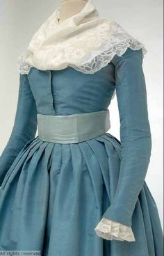 Detail front view, levite or round gown, The Netherlands, 1780-1800. Sky blue silk taffeta with a light blue silk sash.
