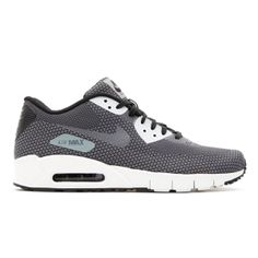 8853556c36ed The Nike Air Max 90 Jacquard s upper is covered in shades of light and dark  grey with white and black accents appearing throughout.
