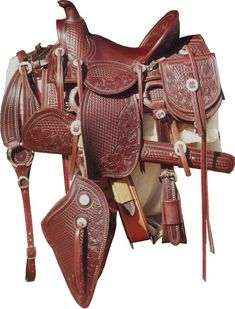 This traditional visalia cowboy or cowgirl rig has it all! Half basket half floral tooling and Nickle conchas. matching stirrups and Taps. Available matching items shown can be ordered separately: Tapedaras, Saddle pockets, Breast collar, Canteen, Rifle scabbard and Cantle pouch.  This is a fantastic rig for  the period rider, trail rider or any rider who love the old west