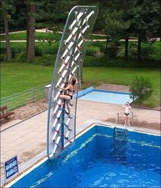 Poolside rock climbing wall. Now this is such a cool idea!