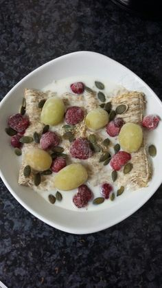 Breakfast is 2 shredded wheat biscuits with unsweetened almond milk, 1/2 tbsp of pumpkin seeds, frozen berries and grapes.