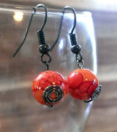 Fiery hot marbled bead with a swirl on a french hook wire by lovinMYLIFEstyle on Etsy