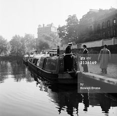 "Captioned: ""August 1958: A canal boat on one of London's waterways."" #london #canal #little #venice #waterbus #british #waterways #barge #narrowboat #wideboat #paddington"
