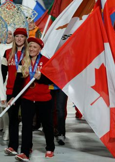 Canada's flag bearers, bobsledders Kaillie Humphries and Heather Moyse take part in the Closing Ceremony at the Sochi Olympics Canadian Winter, Canadian Girls, Kaillie Humphries, Canada Holiday, Personal And Professional Development, Commonwealth Games, Olympic Athletes, Winter Games, Canada Day