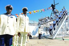 Members of the Nigerian Navy stand in formation as members of the U.S. Coast Guard disembark the decommissioned Coast Guard Cutter Gallatin ...