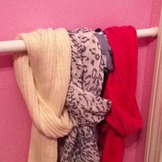 Organize your scarves Using an old shower rod.. Can be used for belts etc and fits into the smallest space :-)